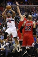 Apr 5, 2014; Washington, DC, USA; Washington Wizards forward Trevor Booker (35) shoots the ball over Chicago Bulls guard Kirk Hinrich (12) in the second quarter at Verizon Center. Mandatory Credit: Geoff Burke-USA TODAY Sports
