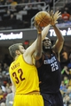 Apr 5, 2014; Cleveland, OH, USA; Charlotte Bobcats center Al Jefferson (25) drives against Cleveland Cavaliers center Spencer Hawes (32) in the second quarter at Quicken Loans Arena. Mandatory Credit: David Richard-USA TODAY Sports
