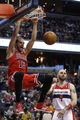 Apr 5, 2014; Washington, DC, USA; Chicago Bulls center Joakim Noah (13) dunks the ball in front of Washington Wizards center Marcin Gortat (4) in the fourth quarter at Verizon Center. The Bulls won 96-78. Mandatory Credit: Geoff Burke-USA TODAY Sports