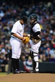 Apr 5, 2014; Denver, CO, USA; Colorado Rockies catcher Jordan Pacheco (58) talks to starting pitcher Jorge De La Rosa (29) early in the first second inning at Coors Field. Mandatory Credit: Ron Chenoy-USA TODAY Sports