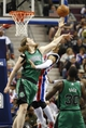 Apr 5, 2014; Auburn Hills, MI, USA; Detroit Pistons guard Peyton Siva (34) gets fouled by Boston Celtics center Kelly Olynyk (41) during the second quarter at The Palace of Auburn Hills. Mandatory Credit: Raj Mehta-USA TODAY Sports