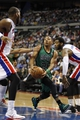 Apr 5, 2014; Auburn Hills, MI, USA; Boston Celtics guard Phil Pressey (26) is defended by Detroit Pistons center Andre Drummond (right) and forward Greg Monroe (left) during the second quarter at The Palace of Auburn Hills. Mandatory Credit: Raj Mehta-USA TODAY Sports
