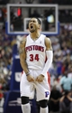 Apr 5, 2014; Auburn Hills, MI, USA; Detroit Pistons guard Peyton Siva (34) celebrates after forward Jonas Jerebko (not pictured) makes a three pointer during the fourth quarter against the Boston Celtics at The Palace of Auburn Hills. Pistons beat the Celtics 115-111. Mandatory Credit: Raj Mehta-USA TODAY Sports