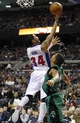 Apr 5, 2014; Auburn Hills, MI, USA; Detroit Pistons guard Peyton Siva (34) takes a shot while defended by Boston Celtics guard Phil Pressey (26) during the fourth quarter at The Palace of Auburn Hills. Pistons beat the Celtics 115-111. Mandatory Credit: Raj Mehta-USA TODAY Sports