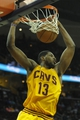 Apr 5, 2014; Cleveland, OH, USA; Cleveland Cavaliers forward Tristan Thompson (13) dunks the ball in the third quarter against the Charlotte Bobcats at Quicken Loans Arena. Mandatory Credit: David Richard-USA TODAY Sports