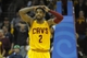 Apr 5, 2014; Cleveland, OH, USA; Cleveland Cavaliers guard Kyrie Irving (2) reacts after missing a shot in overtime against the Charlotte Bobcats at Quicken Loans Arena. Mandatory Credit: David Richard-USA TODAY Sports