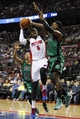 Apr 5, 2014; Auburn Hills, MI, USA; Detroit Pistons forward Josh Smith (6) is defended by Boston Celtics guard Phil Pressey (26) and forward Jeff Green (8) during the third quarter at The Palace of Auburn Hills. Pistons beat the Celtics 115-111. Mandatory Credit: Raj Mehta-USA TODAY Sports