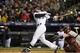 Apr 5, 2014; Denver, CO, USA; Colorado Rockies third baseman Nolan Arenado (28) hits a double in the eighth inning against the Arizona Diamondbacks at Coors Field. The Rockies defeated the Diamondbacks 9-4. Mandatory Credit: Ron Chenoy-USA TODAY Sports
