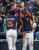 Apr 6, 2014; Houston, TX, USA; Houston Astros catcher Jason Castro (15) is congratulated by shortstop Jonathan Villar (6) after hitting a home run during the first inning against the Los Angeles Angels at Minute Maid Park. Mandatory Credit: Troy Taormina-USA TODAY Sports