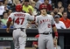 Apr 6, 2014; Houston, TX, USA; Los Angeles Angels second baseman Howie Kendrick (47) is congratulated by center fielder Mike Trout (27) after scoring a run during the fifth inning against the Houston Astros at Minute Maid Park. Mandatory Credit: Troy Taormina-USA TODAY Sports