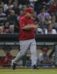 Apr 6, 2014; Houston, TX, USA; Los Angeles Angels manager Mike Scioscia (14) walks out to the mound for a pitching change during the sixth inning against the Houston Astros at Minute Maid Park. Mandatory Credit: Troy Taormina-USA TODAY Sports