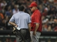 Apr 6, 2014; Houston, TX, USA; Los Angeles Angels manager Mike Scioscia (14) talks with home plate umpire Chris Guccione during the sixth inning against the Houston Astros at Minute Maid Park. Mandatory Credit: Troy Taormina-USA TODAY Sports