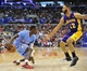 April 6, 2014; Los Angeles, CA, USA; Los Angeles Clippers guard Darren Collison (2) controls the ball against Los Angeles Lakers guard Kendall Marshall (12) during the second half at Staples Center. Mandatory Credit: Gary A. Vasquez-USA TODAY Sports