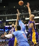 April 6, 2014; Los Angeles, CA, USA; Los Angeles Clippers guard Darren Collison (2) shoots against the defense of Los Angeles Lakers center Robert Sacre (50) and guard Kendall Marshall (12) during the second half at Staples Center. Mandatory Credit: Gary A. Vasquez-USA TODAY Sports
