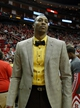 Apr 6, 2014; Houston, TX, USA; Houston Rockets center Dwight Howard (12) wears a suit and bow tie during the second quarter against the Denver Nuggets at Toyota Center. Mandatory Credit: Andrew Richardson-USA TODAY Sports