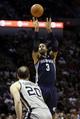 Apr 6, 2014; San Antonio, TX, USA; Memphis Grizzlies forward James Johnson (3) shoots the ball over San Antonio Spurs guard Manu Ginobili (20) during the second half at AT&T Center. Mandatory Credit: Soobum Im-USA TODAY Sports