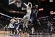 Apr 6, 2014; San Antonio, TX, USA; Memphis Grizzlies forward James Johnson (3) shoots the ball as San Antonio Spurs forward Matt Bonner (15) defends during the second half at AT&T Center. The Spurs won 112-92. Mandatory Credit: Soobum Im-USA TODAY Sports