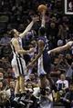 Apr 6, 2014; San Antonio, TX, USA; San Antonio Spurs guard Manu Ginobili (20) shoots as Memphis Grizzlies guard Jamaal Franklin (right) defends during the second half at AT&T Center. The Spurs won 112-92. Mandatory Credit: Soobum Im-USA TODAY Sports