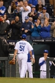 Apr 7, 2014; Kansas City, MO, USA; Kansas City Royals starting pitcher Jason Vargas (51) is relieved to a standing ovation in the ninth inning of the game against the Tampa Bay Rays at Kauffman Stadium. The Royals won 4-2.  Mandatory Credit: Denny Medley-USA TODAY Sports