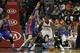 Apr 8, 2014; Atlanta, GA, USA; Detroit Pistons forward Jonas Jerebko (33) defends Atlanta Hawks forward Paul Millsap (4) in the second quarter at Philips Arena. Mandatory Credit: Brett Davis-USA TODAY Sports