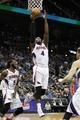 Apr 8, 2014; Atlanta, GA, USA; Atlanta Hawks forward Paul Millsap (4) grabs a rebound against the Detroit Pistons in the second quarter at Philips Arena. Mandatory Credit: Brett Davis-USA TODAY Sports
