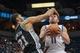 Apr 8, 2014; Minneapolis, MN, USA; San Antonio Spurs forward Tim Duncan (21) fouls Minnesota Timberwolves guard J.J. Barea (11) in the second quarter at Target Center. Mandatory Credit: Brad Rempel-USA TODAY Sports