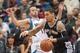 Apr 8, 2014; Minneapolis, MN, USA; San Antonio Spurs guard Danny Green (4) dribbles in the second quarter against the Minnesota Timberwolves guard J.J. Barea (11) at Target Center. Mandatory Credit: Brad Rempel-USA TODAY Sports