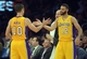 Apr 8, 2014; Los Angeles, CA, USA; Los Angeles Lakers guard Steve Nash (10) is congratulated by guard Kendall Marshall (12) after passing Mark Jackson (not pictured) to move into third on the all-time NBA assist list in the second quarter against the Houston Rockets at Staples Center. Mandatory Credit: Kirby Lee-USA TODAY Sports