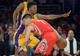 Apr 8, 2014; Los Angeles, CA, USA; Houston Rockets guard Jeremy Lin (7) is defended by Los Angeles Lakers guard Nick Young (0) at Staples Center. Mandatory Credit: Kirby Lee-USA TODAY Sports