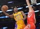 Apr 8, 2014; Los Angeles, CA, USA; Los Angeles Lakers guard Jodie Meeks (20) is defended by Houston Rockets forward Omri Casspi (18) at Staples Center. Mandatory Credit: Kirby Lee-USA TODAY Sports