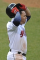 Apr 9, 2014; Cleveland, OH, USA; Cleveland Indians shortstop Asdrubal Cabrera (13) reacts after being the final out against the San Diego Padres at Progressive Field. The Padres won 2-1. Mandatory Credit: David Richard-USA TODAY Sports