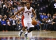 Apr 9, 2014; Toronto, Ontario, CAN; Toronto Raptors guard Kyle Lowry (7) dribbles the ball against the Philadelphia 76ers during the first half at the Air Canada Centre. Mandatory Credit: John E. Sokolowski-USA TODAY Sports