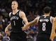 Apr 9, 2014; Orlando, FL, USA; Brooklyn Nets forward Mason Plumlee (1) and guard Deron Williams (8) high five against the Orlando Magic during the second half at Amway Center. Orlando Magic defeated the Brooklyn Nets 115-111. Mandatory Credit: Kim Klement-USA TODAY Sports