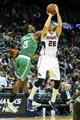 Apr 9, 2014; Atlanta, GA, USA; Atlanta Hawks guard Kyle Korver (26) shoots over Boston Celtics forward Jeff Green (8) in the second half at Philips Arena. The Hawks won 105-97. Mandatory Credit: Daniel Shirey-USA TODAY Sports