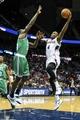 Apr 9, 2014; Atlanta, GA, USA; Atlanta Hawks forward Paul Millsap (4) shoots a basket over Boston Celtics forward Brandon Bass (30) in the second half at Philips Arena. The Hawks won 105-97. Mandatory Credit: Daniel Shirey-USA TODAY Sports