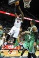 Apr 9, 2014; Atlanta, GA, USA; Atlanta Hawks forward DeMarre Carroll (5) shoots a basket in the second half against the Boston Celtics at Philips Arena. The Hawks won 105-97. Mandatory Credit: Daniel Shirey-USA TODAY Sports
