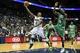 Apr 9, 2014; Atlanta, GA, USA; Atlanta Hawks guard Jeff Teague (0) shoots a basket past Boston Celtics forward Jeff Green (8) in the second half at Philips Arena. The Hawks won 105-97. Mandatory Credit: Daniel Shirey-USA TODAY Sports