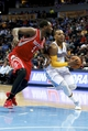 Apr 9, 2014; Denver, CO, USA; Houston Rockets small forward Jordan Hamilton (5) guards Denver Nuggets point guard Randy Foye (4) in the fourth quarter at the Pepsi Center. The Nuggets won 123-116. Mandatory Credit: Isaiah J. Downing-USA TODAY Sports