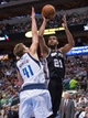 Apr 10, 2014; Dallas, TX, USA; San Antonio Spurs forward Tim Duncan (21) shoots over Dallas Mavericks forward Dirk Nowitzki (41) during the second half at the American Airlines Center. The Spurs defeated the Mavericks 109-100. Mandatory Credit: Jerome Miron-USA TODAY Sports
