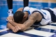 Apr 10, 2014; Dallas, TX, USA; Dallas Mavericks guard Devin Harris (20) is knocked to the floor during the second half against the San Antonio Spurs at the American Airlines Center. The Spurs defeated the Mavericks 109-100. Mandatory Credit: Jerome Miron-USA TODAY Sports