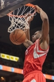 Apr 11, 2014; Minneapolis, MN, USA; Houston Rockets forward Terrence Jones (6) dunks in the first quarter against the Minnesota Timberwolves at Target Center. Mandatory Credit: Brad Rempel-USA TODAY Sports