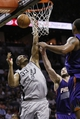 Apr 11, 2014; San Antonio, TX, USA; San Antonio Spurs forward Boris Diaw (33) reaches for the ball as Phoenix Suns center Miles Plumlee (behind) and Phoenix Suns forward Channing Frye (right) defend during the first half at AT&T Center. Mandatory Credit: Soobum Im-USA TODAY Sports