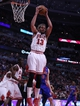 Apr 11, 2014; Chicago, IL, USA; Chicago Bulls center Joakim Noah (13) pulls down a rebound during the second quarter against the Detroit Pistons at the United Center. Mandatory Credit: Dennis Wierzbicki-USA TODAY Sports