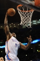 Apr 11, 2014; Oklahoma City, OK, USA; Oklahoma City Thunder forward Serge Ibaka (9) dunks the ball against the New Orleans Pelicans during the second quarter  at Chesapeake Energy Arena. Mandatory Credit: Mark D. Smith-USA TODAY Sports