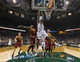 Apr 11, 2014; Milwaukee, WI, USA; Milwaukee Bucks center John Henson (31) shoots as Cleveland Cavaliers guard Kyrie Irving (2) and center Spencer Hawes (32) look on during the second quarter at BMO Harris Bradley Center. Mandatory Credit: Jeff Hanisch-USA TODAY Sports