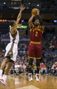 Apr 11, 2014; Milwaukee, WI, USA; Cleveland Cavaliers guard Kyrie Irving (2) shoots against Milwaukee Bucks guard Ramon Sessions (13) during the second quarter at BMO Harris Bradley Center. Mandatory Credit: Jeff Hanisch-USA TODAY Sports