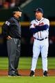 Apr 11, 2014; Atlanta, GA, USA; Atlanta Braves manager Fredi Gonzalez (33) talks to an umpire in the fifth inning against the Atlanta Braves at Turner Field. Mandatory Credit: Daniel Shirey-USA TODAY Sports