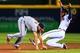 Apr 11, 2014; Atlanta, GA, USA; Washington Nationals second baseman Anthony Rendon (6) stumbles towards Atlanta Braves right fielder Jason Heyward (22) after a force out in the fifth inning at Turner Field. Mandatory Credit: Daniel Shirey-USA TODAY Sports