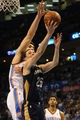 Apr 11, 2014; Oklahoma City, OK, USA;  New Orleans Pelicans guard Austin Rivers (25) attempts a shot against Oklahoma City Thunder center Steven Adams (12) during the fourth quarter at Chesapeake Energy Arena. Mandatory Credit: Mark D. Smith-USA TODAY Sports