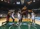 Apr 11, 2014; Milwaukee, WI, USA; Cleveland Cavaliers guard Kyrie Irving (2) shoots as Milwaukee Bucks forward Jeff Adrien (12) defends during the third quarter at BMO Harris Bradley Center. Mandatory Credit: Jeff Hanisch-USA TODAY Sports
